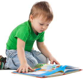 Toddler reading on floor