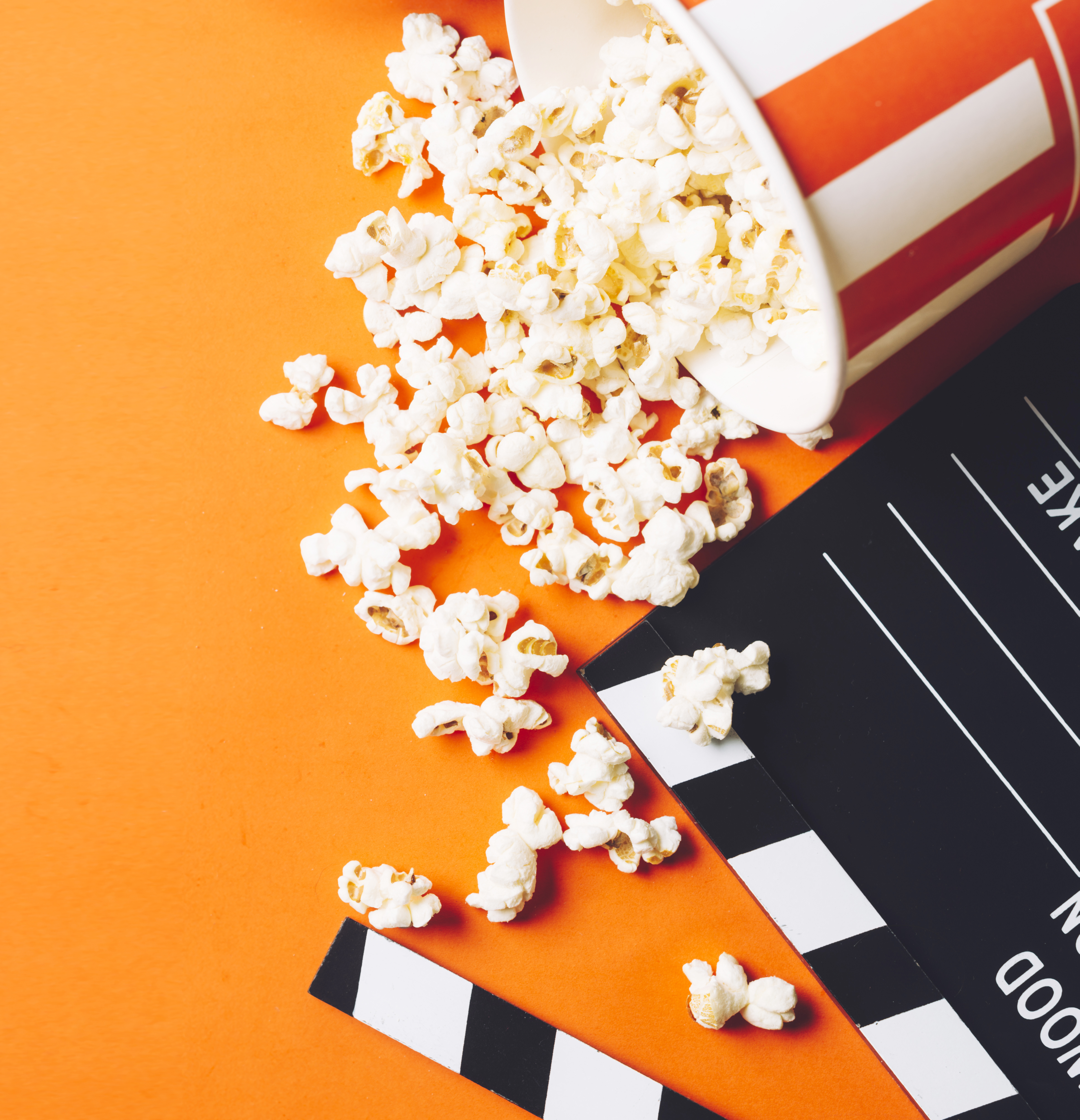 popcorn and movie clapperboard