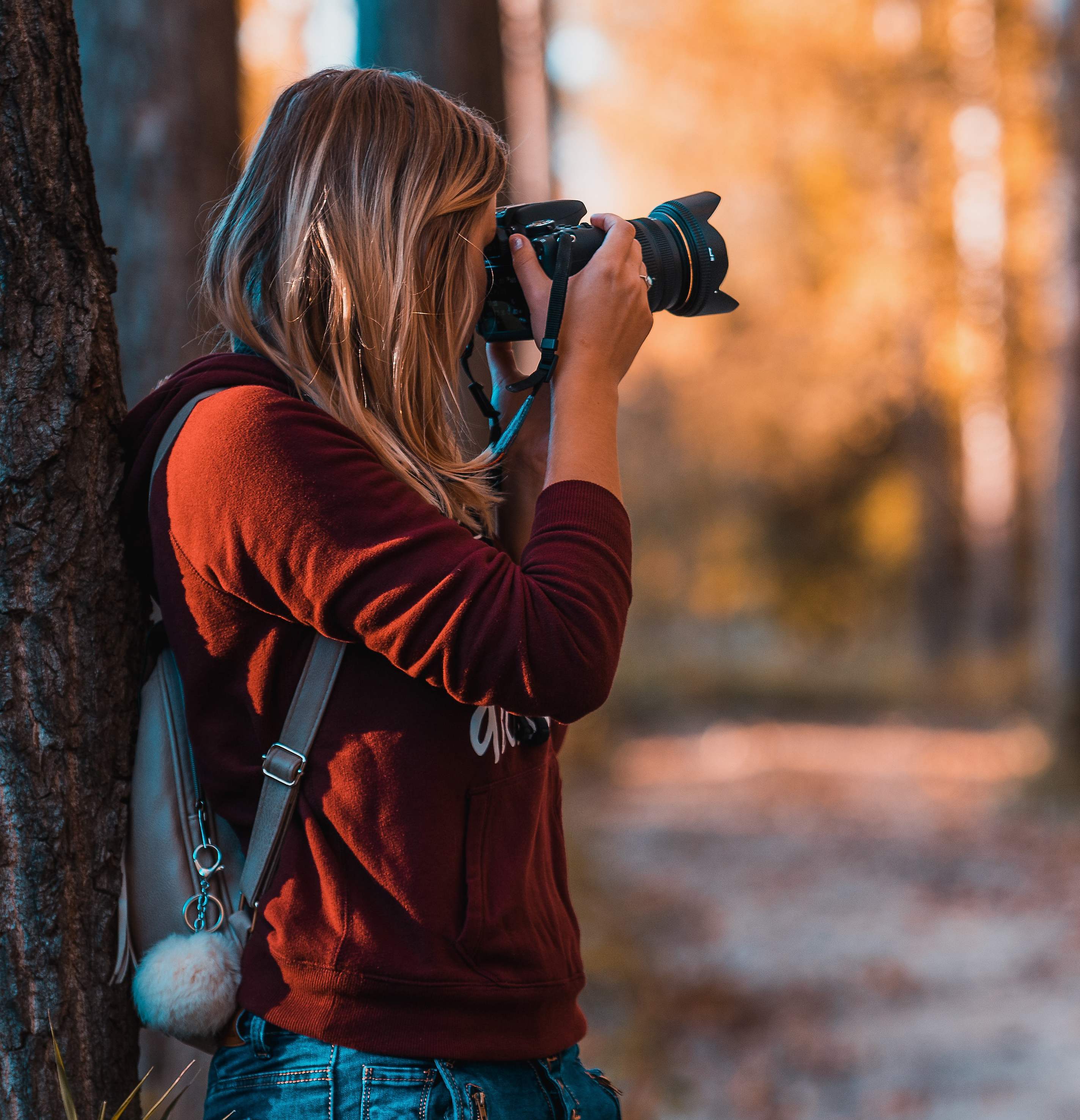 Image of young woman with camera