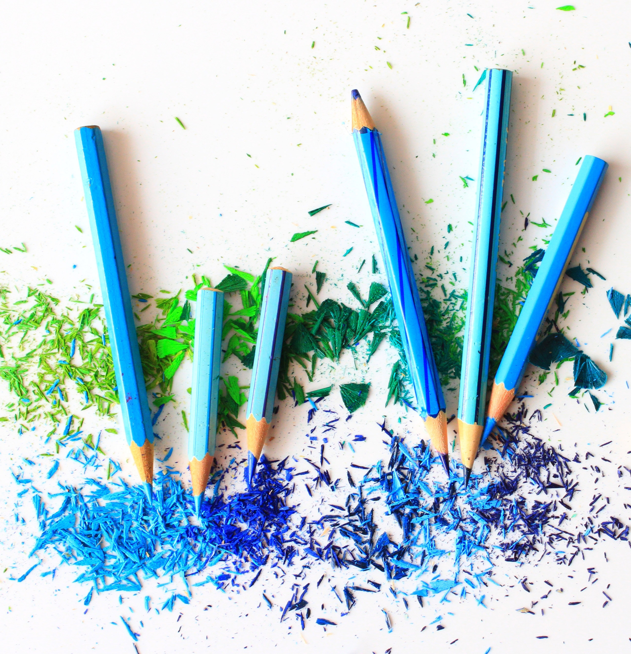 Blue and green pencil shavings and pencils; crafting; drawing