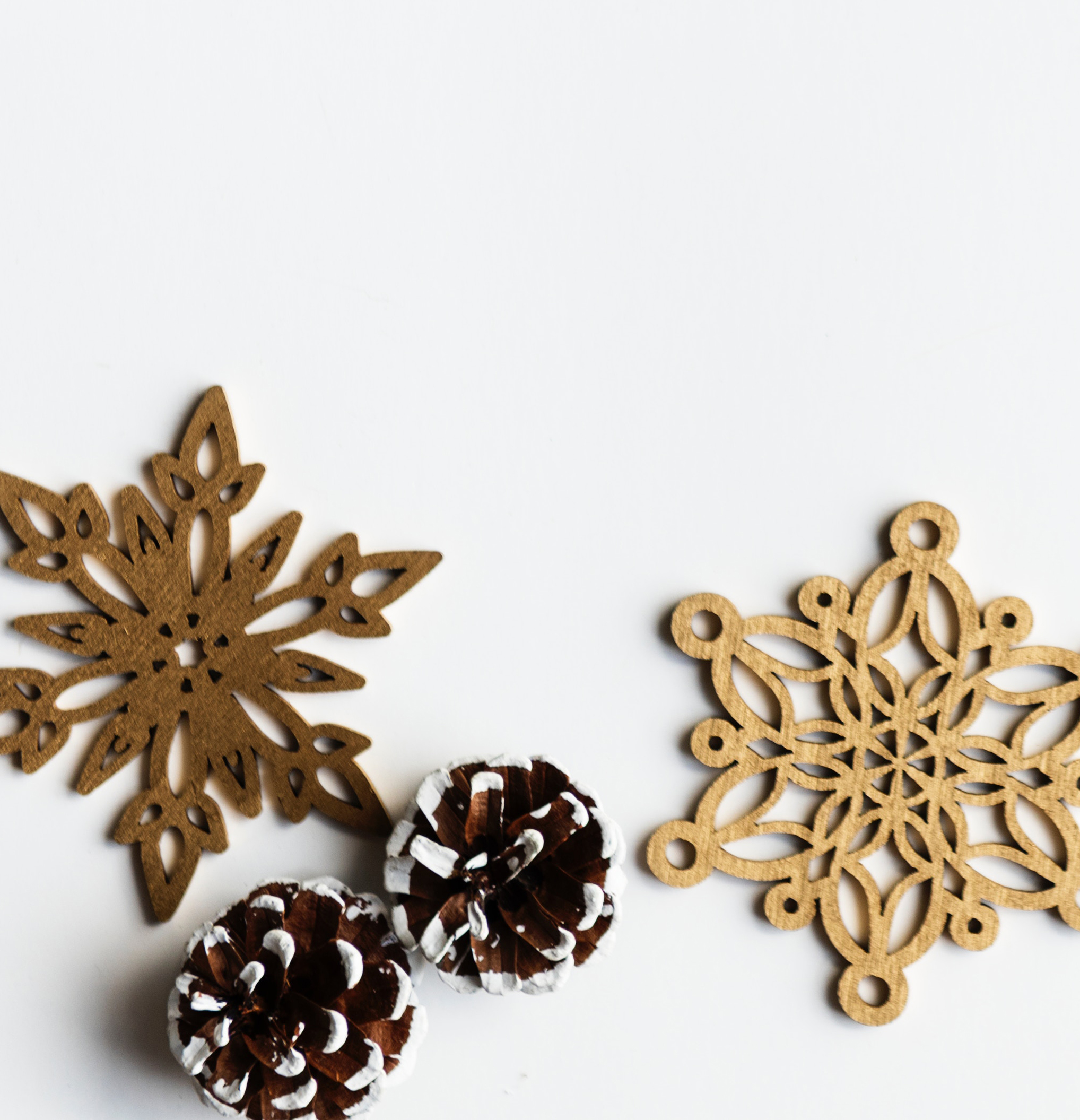 metal snowflakes and painted pine cones