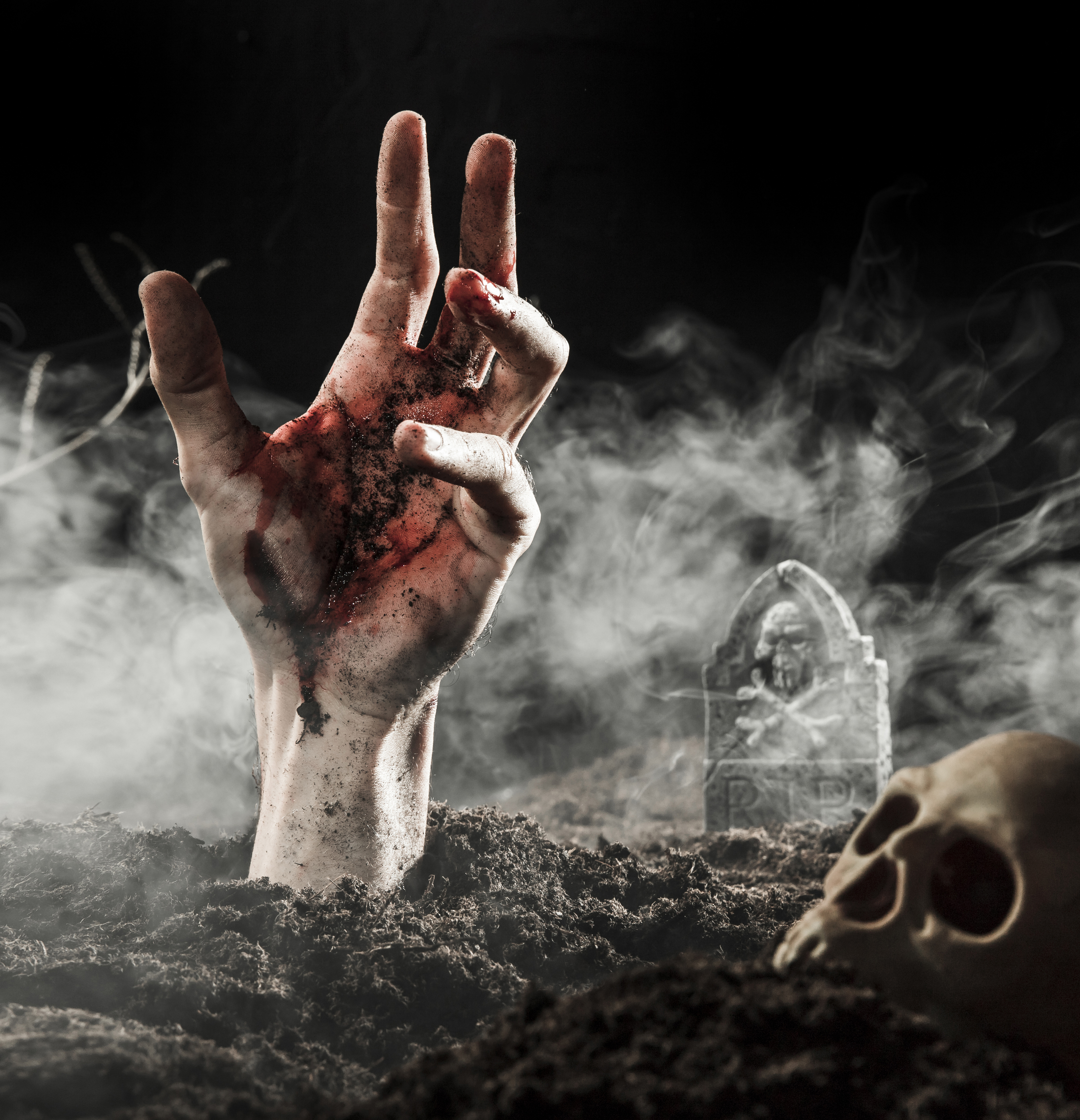 zombie hand reaching out of ground