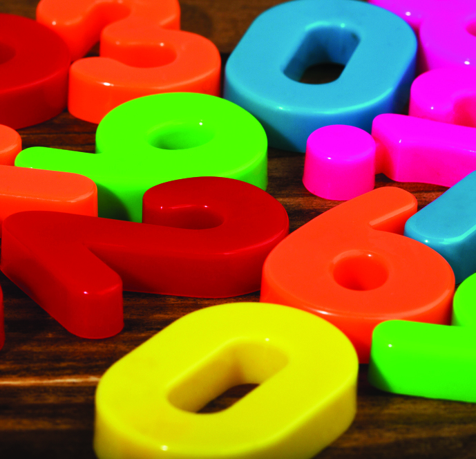 A mixture of large plastic numbers in various colours