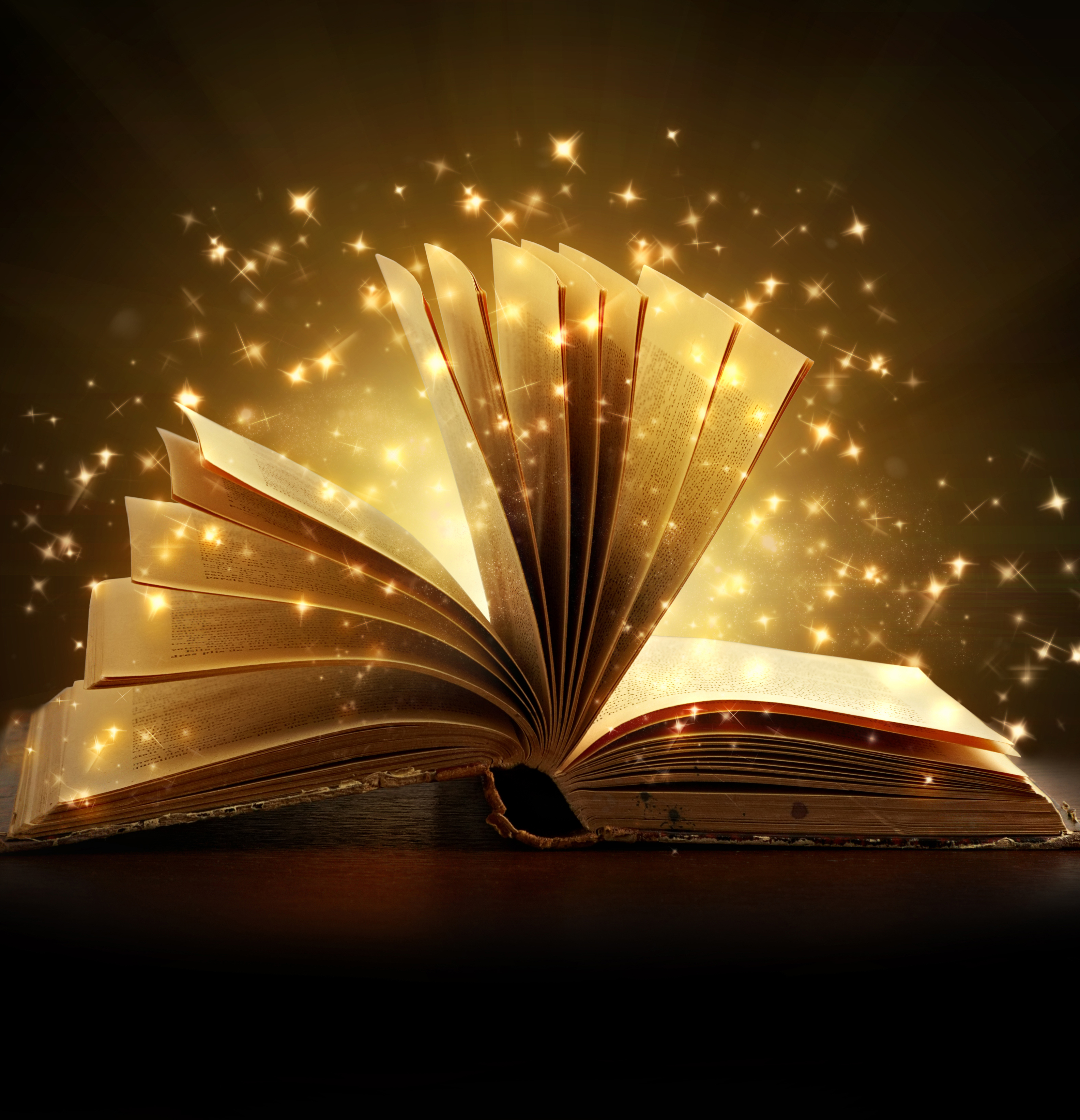 An open book surrounded by bright sparkles