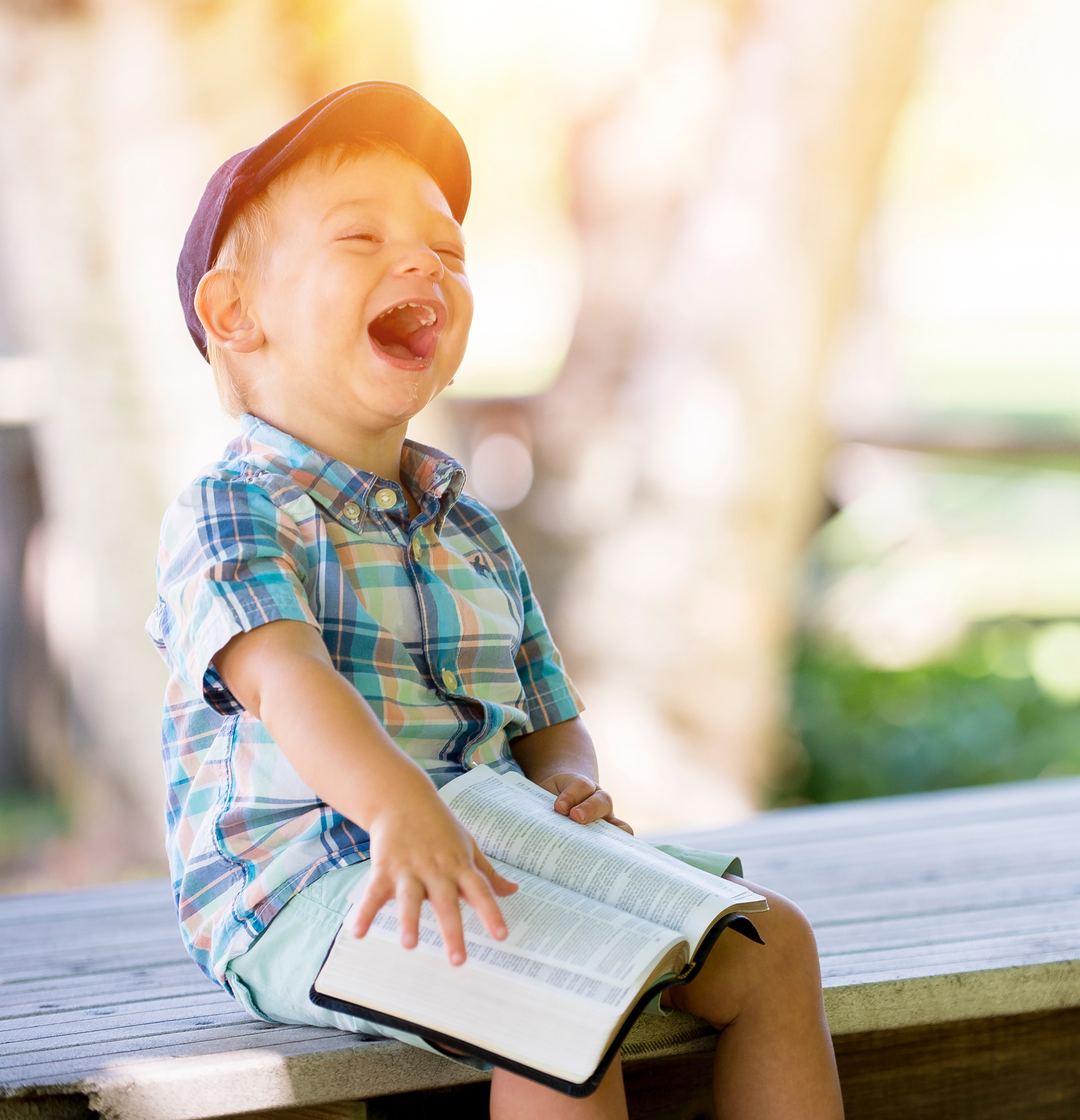 child reading and laughing