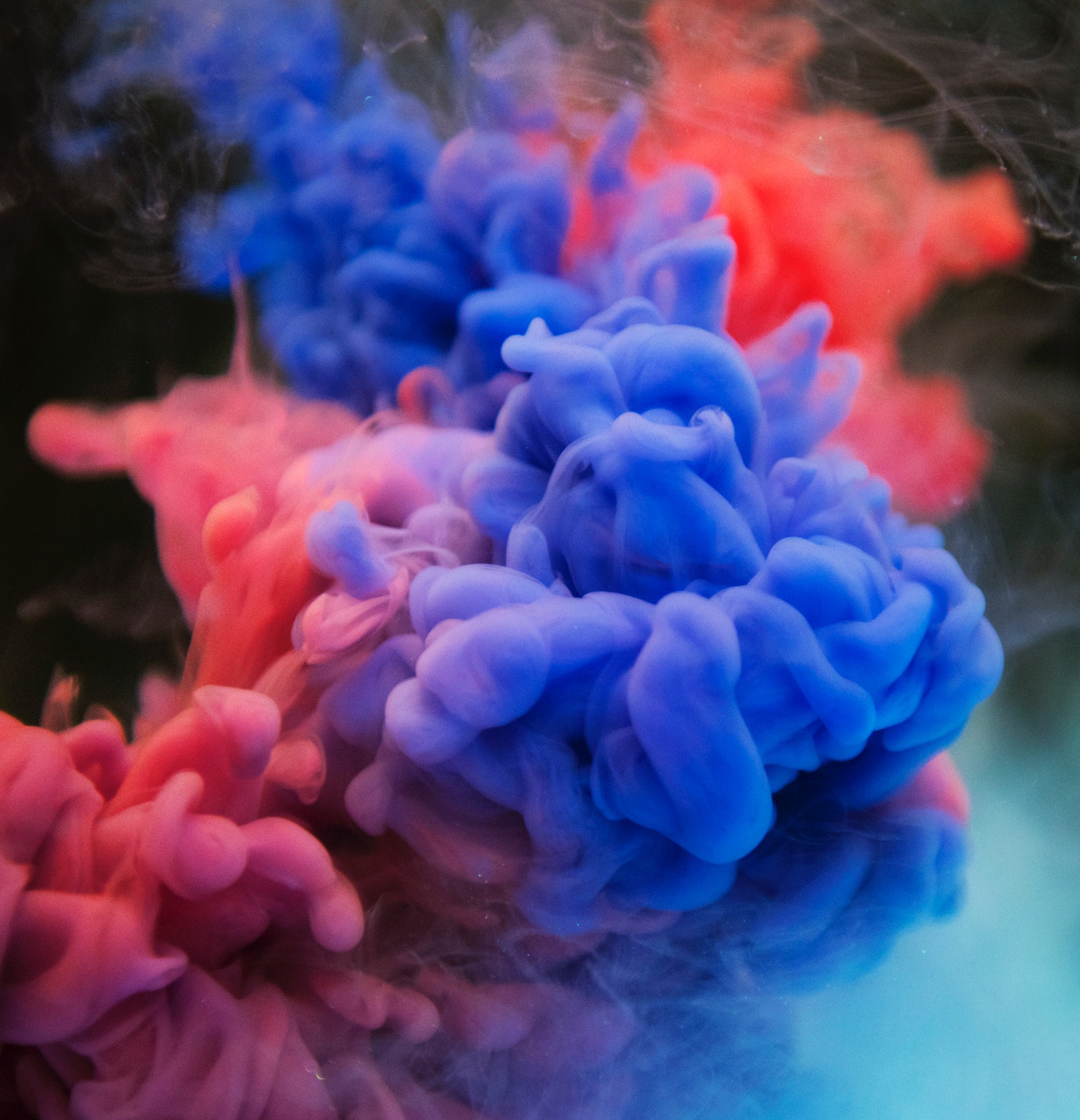 Abstract image of red and blue smoke