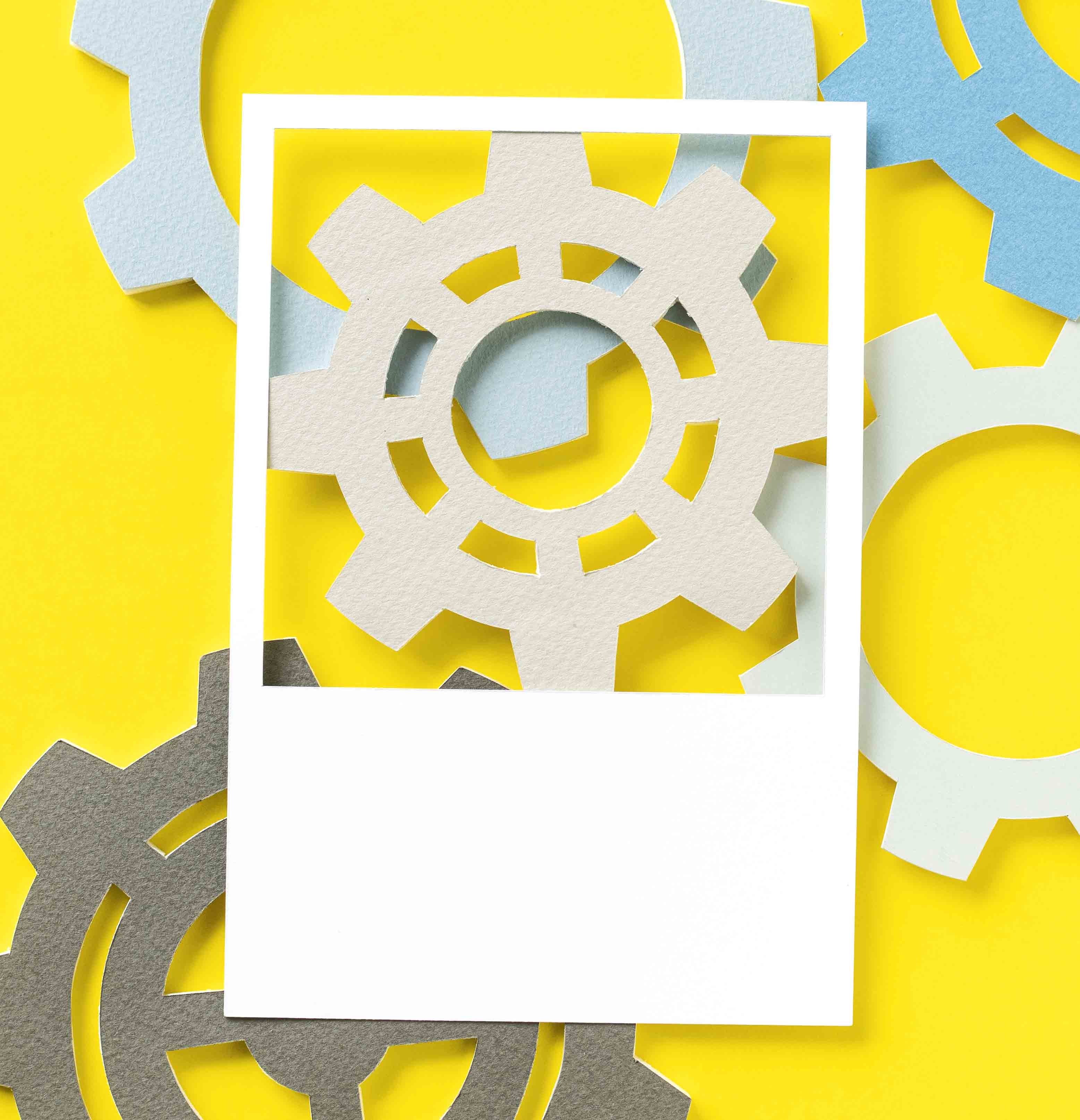 A collection of illustrated gears on a yellow background