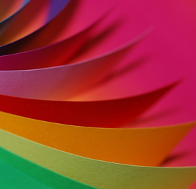 Different coloured paper spread out in a fan
