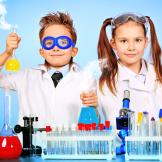 girl and boy in lab coats with test tubes and beakers