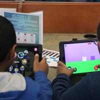 two children playing games on ipads