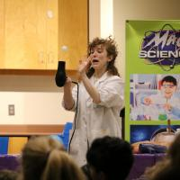 woman and hair dryer for mad science demonstration